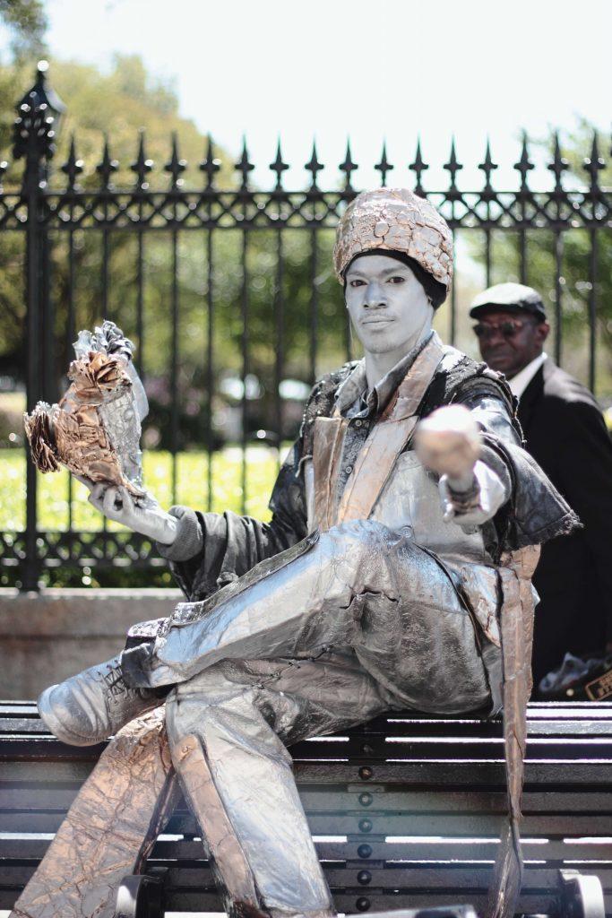 human statue street performer